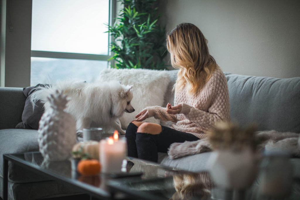 Women sitting on couch with dog